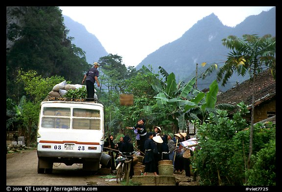 Unloading of a bus in a mountain village. Northeast Vietnam (color)