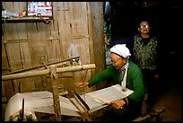 Elderly woman weaving in her home. Northeast Vietnam (color)