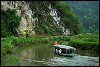 Shallow boats transport villagers to a market. Northeast Vietnam (color)
