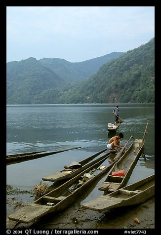 Typical dugout boats on the shore of Ba Be Lake. Northeast Vietnam (color)