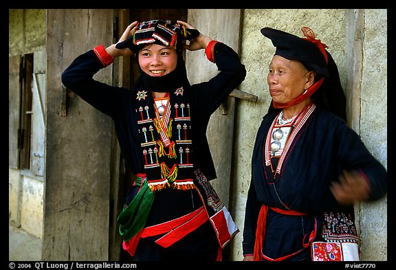 Two generations of tribewomen outside their house, near Mai Chau. Vietnam (color)