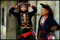 Two generations of tribewomen outside their house, near Mai Chau. Northwest Vietnam (color)