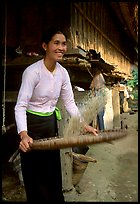 Woman of the Thai ethnicity sorting grain, near Mai Chau. Vietnam (color)