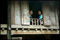 Two thai women at the window of their stilt house, Ban Lac village. Northwest Vietnam