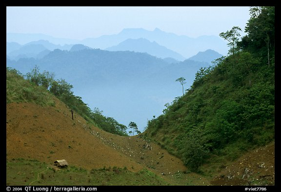House and misty ridges between Moc Chau and Yeu Chau. Northwest Vietnam (color)
