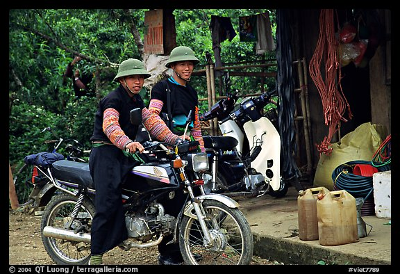 Two Hmong motorcyclists at the Xa Linh market. Northwest Vietnam (color)