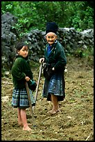 Elderly tribeswoman and girl doing field work  near Yen Chau. Northwest Vietnam