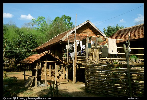 Woman drying laundry in a montagnard village near Son La. Northwest Vietnam (color)