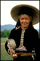 Thai woman wearing her traditional dress under the Vietnamese conical hat, near Son La. Northwest Vietnam