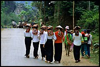 Young thai women walking on the road, between Son La and Tuan Chau. Northwest Vietnam ( color)