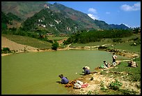 Thai women on the shores of a pond, near Tuan Giao. Northwest Vietnam
