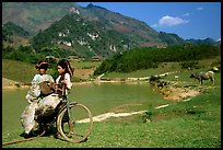 Thai women load a bicycle, near Tuan Giao. Northwest Vietnam (color)
