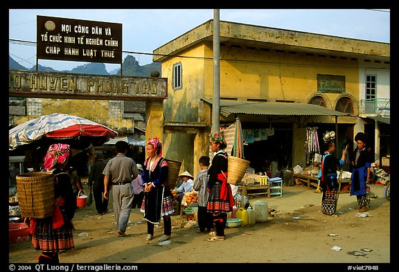 Hmong women near the entrance of the market, Tam Duong. Northwest Vietnam (color)