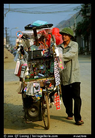 Street vendor uses his bicycle as a shop, Tam Duong. Northwest Vietnam (color)