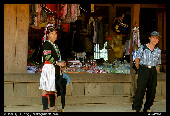 Man and montagnard woman in front of a store, near Lai Chau. Northwest Vietnam (color)