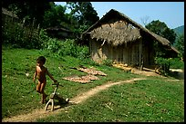 Unclothed child in a minority village, between Lai Chau and Tam Duong. Northwest Vietnam (color)