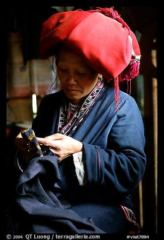 Red Dzao women sewing. Vietnam (color)