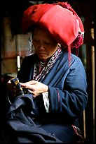 Red Dzao women sewing. Vietnam