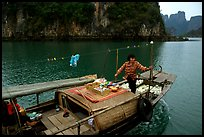 Peddling from a boat. Halong Bay, Vietnam ( color)