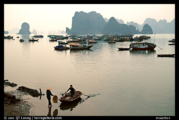 Rowboat meeting woman on shore. Halong Bay, Vietnam (color)