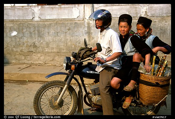 Black Hmong Women riding at the back of a Russian motorbike. Sapa, Vietnam (color)