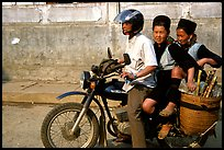 Black Hmong Women riding at the back of a Russian motorbike. Sapa, Vietnam