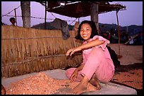 Girl drying shrimp. Ha Tien, Vietnam (color)