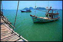Fishing boats in the China sea. Hong Chong Peninsula, Vietnam (color)