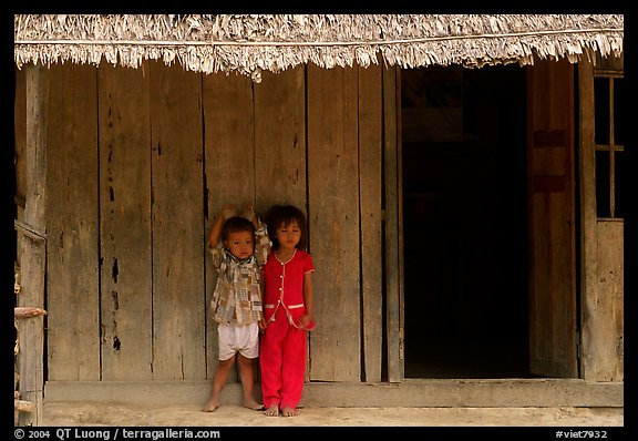 Two kids in front of a hut. Hong Chong Peninsula, Vietnam (color)