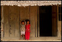 Two kids in front of a hut. Hong Chong Peninsula, Vietnam