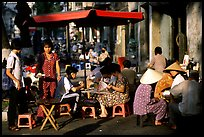Eating in a street restaurant. Ho Chi Minh City, Vietnam (color)