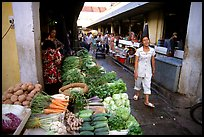 Vegetables for sale in an alley of the Ben Than Market. Ho Chi Minh City, Vietnam (color)
