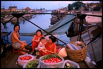 Family selling fruit on a bridge. Cholon, Ho Chi Minh City, Vietnam ( color)