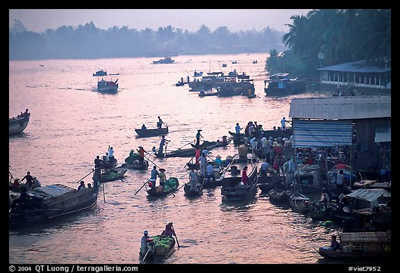 Busy river  at sunrise. Can Tho, Vietnam (color)