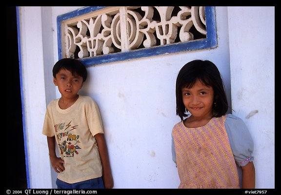 Two kids in front of a wall, Ben Tre. Mekong Delta, Vietnam