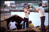 Unloading watermelons from a boat. Ha Tien, Vietnam (color)