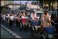 Cyclos and morning traffic. Ho Chi Minh City, Vietnam ( color)