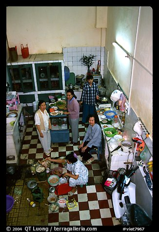 Women in a home kitchen. Ho Chi Minh City, Vietnam (color)