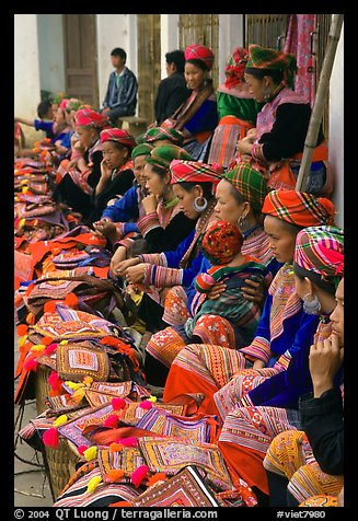 Flower hmong women sell colorful clothing at the market. Bac Ha, Vietnam