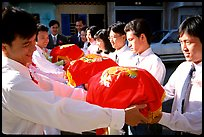 Gifts are exchanged in front of the bride's home. Ho Chi Minh City, Vietnam (color)