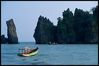 Small boats and offshore rock formations. Hong Chong Peninsula, Vietnam (color)