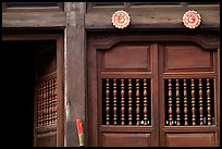 Detail of a wooden facade, Hoi An. Hoi An, Vietnam