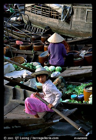 Child at Phung Hiep floating market. Can Tho, Vietnam (color)
