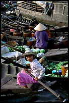 Child at Phung Hiep floating market. Can Tho, Vietnam ( color)