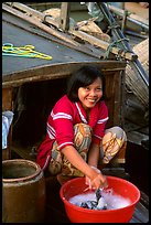 Woman doing laundry on live-aboard boat, the cheapest and most convenient housing in the Delta, near Can Tho. Vietnam