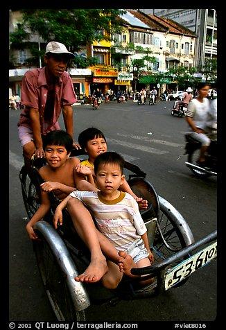 Kids sharing cyclo ride, Ho Chi Minh city. Vietnam (color)