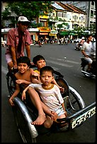 Kids sharing cyclo ride, Ho Chi Minh city. Vietnam (color)