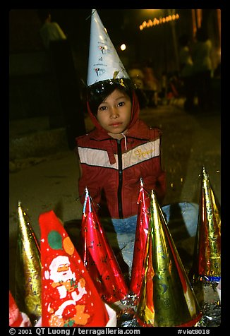 Child on Christmas night. Ho Chi Minh City, Vietnam (color)