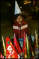 Child on Christmas night. Ho Chi Minh City, Vietnam