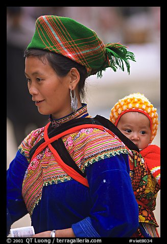 Young Flower Hmong woman and baby. Bac Ha, Vietnam (color)